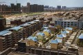 According to local media, 25 houses built without government permission on a furniture shopping mall in Hengyang, Hunan province, are now being used as dormitories. Photo: Reuters