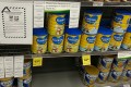A recall notice for Karicare Gold+ Follow On Formula Stage 2 and other baby formula seen on a supermarket shelf in Wellington, New Zealand, last  Sunday. Photo: Xinhua