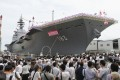 "Japan's new warship ""Izumo"" is unveiled in Yokohama. Photo: AP"