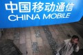 China Mobile led the strong growth in 3G users on the mainland, with subscriber number hitting 137.88 million in June. Photo: Reuters