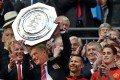 Manchester United manager David Moyes lifts the Community Shield after his side defeated Wigan 2-0 at a sun-baked Wembley yesterday. Photo: EPA