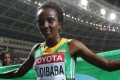 Ethiopia's Tirunesh Dibaba drapes herself in her national flag after winning the 10,000 metres at the world championships. Photo: AFP