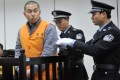 Fei Liangyu appears in court in Yueqing. He was jailed for three-and-a-half years for running over and killing Qian Yunhui, who led a fight for compensation over a land seizure. Photo: Xinhua