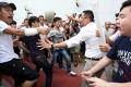 Protesters clash while Chief Executive Leung Chun-ying attends the public forum at Tin Ching Community Hall in Tin Shui Wai. Photo: K. Y. Cheng