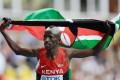 Ezekiel Kemboi of Kenya celebrates his world title. Photo: Xinhua