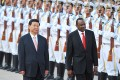 Chinese President Xi Jinping and Kenya's President Uhuru Kenyatta inspect Chinese honour guards during a welcoming ceremony outside the Great Hall of the People in Beijing on Monday. Photo: AFP