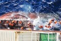 Asylum-seekers are rescued from a boat after it began sinking north of Australia. Photo: SCMP Pictures