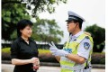 Bo's wife Gu Kailai with his former right-hand man Wang Lijun, in uniform - the pair became very close, according to Bo. Photo: SCMP