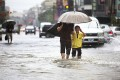 Local residents walk through floodwaters from passing Tropical Storm Kong-Rey in Tainan, Taiwan, on Thursday. Photo: AP