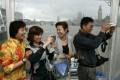 Chinese tourists on the River Thames in London. Photo: Reuters