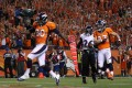 Julius Thomas of the Denver Broncos (left) celebrates in the end zone after scoring a touchdown on a pass from Peyton Manning. Photo: AFP