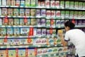 A customer selects baby formula in Haikou, Hainan province as foreign suppliers were fined for price-fixing. Photo: AFP