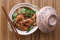 Clay pot shrimp with glass vermicelli, salted yellow beans, pork, green peppercorns and Thai basil