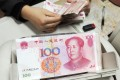The yuan is getting more popular in settling global trade, underscoring the strength of China's economy. It is the ninth most used currency this month. Photo: AFP