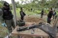 Thai security personnel inspect the site of a bomb attack at a school in Yala province on Monday. A bomb attack by suspected Muslim rebels on a school in southern Thailand killed two soldiers on Tuesday. Photo: Reuters