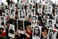 Chileans hold up pictures of victims of human rights abuse during a ceremony commemorating 40 years of the military coup at the Parque Por La Paz in Santiago. Photo: Reuters