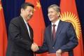 President Xi Jinping (left) and Kyrgyz President Almazbek Atambayev shake hands in Bishkek, Kyrgyzstan on Wednesday. Photo: AP
