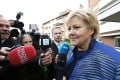 Erna Solberg speaks with the media outside the block of flats where she lives in Oslo. Photo: Reuters