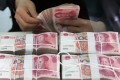 The yuan is expected to make a smaller gain this year. Photo: Xinhua