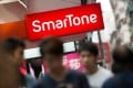 SmarTone shares dropped 15 per cent yesterday after announcing a cut in its payout ratio on Wednesday. Photo: Bloomberg
