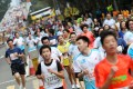 Mobile phones could be banned from next February's Standard Chartered Hong Kong Marathon after runners were accused of causing pandemonium at this year's event by stopping to take pictures of themselves. Photo: David Wong