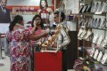 Customers browse in a Mumbai shoe shop. Indian landlords are being forced to negotiate with tenants – or face leaving valuable real estate lying idle. Photo: Reuters