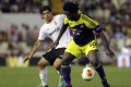 Swansea City's Wilfried Bony (R) and Valencia's Ever Banega fight for the ball during their Europa League soccer match at the Mestalla stadium in Valencia. Photo: Reuters