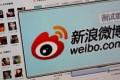 """A logo of Sina Corp's Chinese microblog website """"weibo."""" Photo: Reuters"""