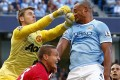 Manchester United goalkeeper David de Gea hits City's Vincent Kompany in the face during their English Premier League match at Etihad Stadium. Photo: Reuters
