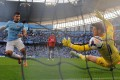 Manchester City's Sergio Aguero scores his team's third goal past Manchester United keeper David de Gea at the Etihad Stadium. Photo: AFP