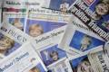 Angela Merkel's election victory grabs the headlines across Germany. Photo: AFP