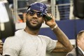 """LeBron """"King"""" James relaxes at an NFL match. Photo: AFP"""