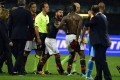 AC Milan's Mario Balotelli argues with referee Luca Banti after their Serie A match with Naples. Photo: AFP