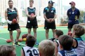 Port Adelaide players Tom Logan (left) and Tom Jones, with club legend Russell Ebert and HKFC's Warwick Kendall at a coaching clinic in Happy Valley. Photo: Edmond So