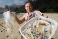 Tracey Read, founder and CEO of Plastic Free Seas shows a bunch of medical wastes collected from a beach in Discovery Bay. Photo: SCMP