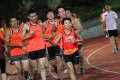 Kate Cheung helps guide blind and deaf runners at Hammer Hill Sports Ground, Choi Hung. Photo: SCMP Pictures