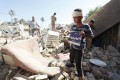 Civilians look at a damaged Shiite mosque a day after a suicide bomb attack in Mussayab. Photo: Reuters