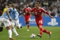 Bayern's Mario Goetze, right, and Manchester City's Vincent Kompany challenge for the ball. Photo: AP