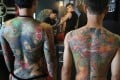 Models show off their full back tattoos by award-winning Taiwanese artist Chen Cheng Hsiung, better known as Diau An. Photo: K.Y. Cheng