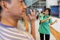 Mindy Lai (right) leads a deaf group on a visit to the Hong Kong Museum of History in Tsim Sha Tsui. Photo: Edward Wong