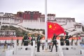 Soldiers at a flag-raising ceremony in front of the Potala Palace in Lhasa, capital of southwest China's Tibet Autonomous Region. Photo: Xinhua