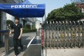 A worker leaves a Foxconn factory in the township of Longhua in Shenzhen, Guangdong province. Photo: Reuters