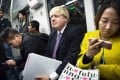 Boris Johnson takes a ride on Beijing's subway on Tuesday. Photo: Weibo screenshot