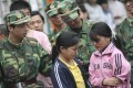 Two child slave workers are rescued from a factory in Dongguan, China. Photo: Reuters