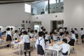 Lunchtime at a primary school cafeteria in Japan, where good manners and mutual help are staples. Photo: Corbis