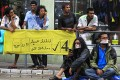 Supporters of Maldives former president Mohamed Nasheed with their mouths covered during a silent protest in Male on Monday. Photo: AP