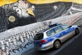 """A mural in Cologne depicts the emblematic US eagle with a badge that reads """"National Security Agency worldwide"""". Photo: Reuters"""