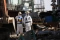 Workers wear protective suits and masks are at the No 4 reactor in Fukushima Dai-ichi. Photo: Reuters