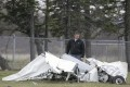 An FAA investigator examines debris from the crash in Wisconsin, which involved experienced skydiving instructors and pilots. Photo: AP