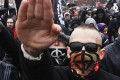 Russian nationalists attend a 'Russian March' demonstration on National Unity Day in Moscow on Monday. Photo: Reuters